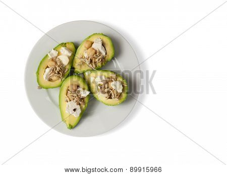 Bunch of avocado halves with cheese and nuts