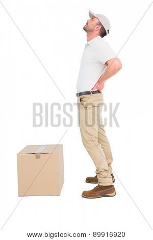 Delivery man suffering from backache on white background