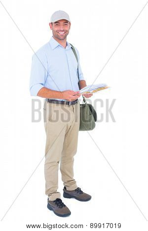 Full length portrait of happy postman with letters on white background