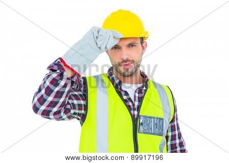 Handyman with reflecting clothes on white background