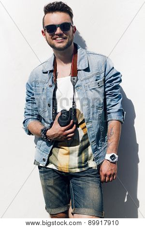 Closeup Of Young Hipster Man With Camera Smilling