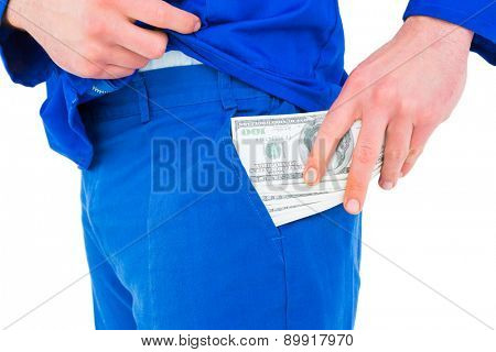 Handyman putting money in his pocket on white background