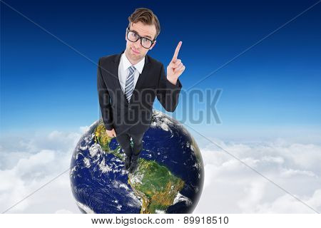 Geeky hipster businessman with finger up against blue sky over clouds