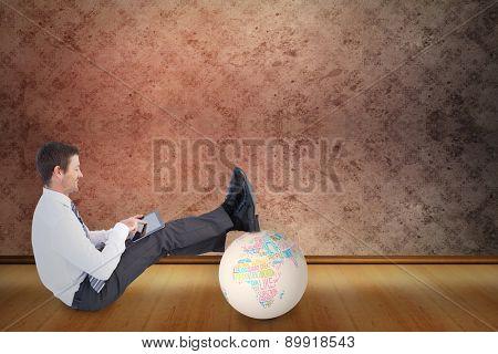 Businessman using tablet against grimy room