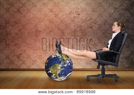 Businesswoman sitting on swivel chair with feet up against grimy room