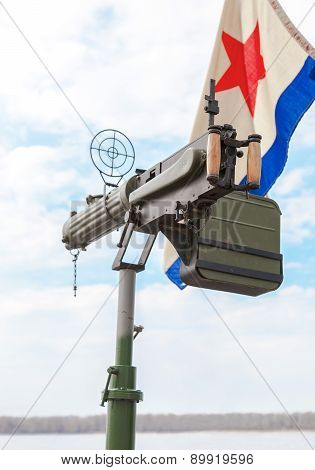 Old Anti-aircraft Machine Gun Maxim In The Background Of The Flag Of The Soviet Navy