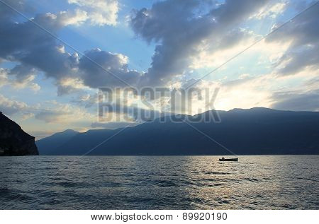 Lonely Fishing Boat In The Early Morning At Garda Lake