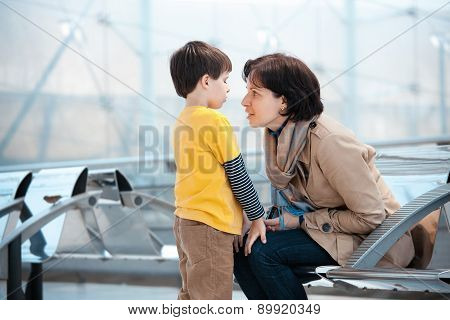Loving mother and son at airport