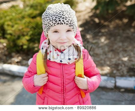 Little girl in bright clothes, spring season