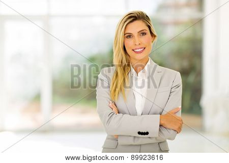 portrait of young career woman with arms folded