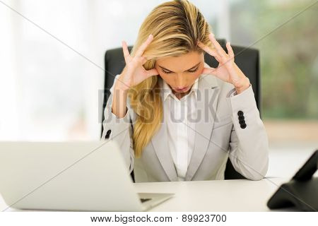 overworked businesswoman sitting in office