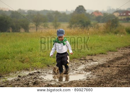 Little Boy And Puddles
