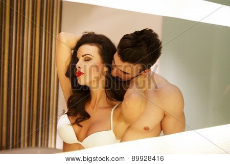 Sexy Milf Woman With Young Lover Posing In Mirror
