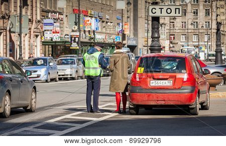 Russian Traffic Police Inspector Checks Documents
