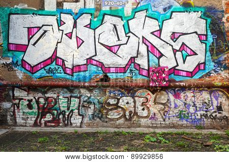 Colorful Abstract Graffiti Text Patterns On Brick Wall