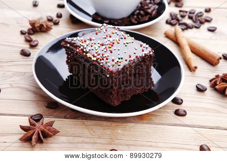 dessert : hot black coffee and chocolate cake with cinnamon , coffee beans, and anise star