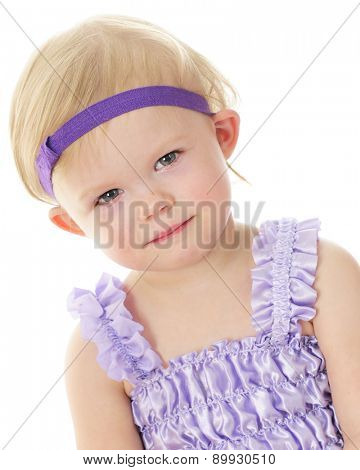 A close-up portrait of an adorable blond 2-year-old girl.  On a white background.