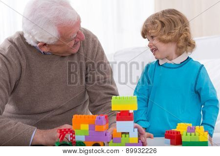 Grandfather And Grandson Playing Bricks