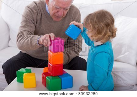 Child Playing With Color Cubes