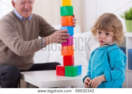 Kindergartner And Colorful Building Blocks