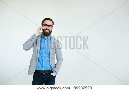 Hipster In Glasses Talking Phone Isolated On White Background