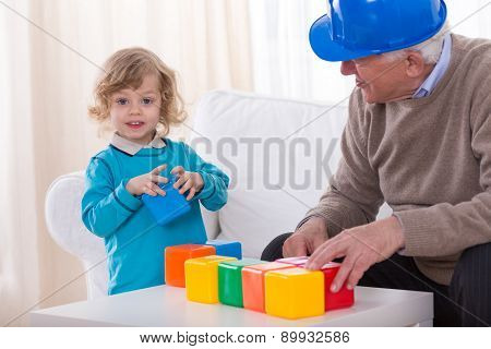 Toddler Playing With Colorful Cubes