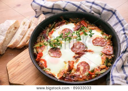 Spanish Food: eggs over Flemish, a pan closeup