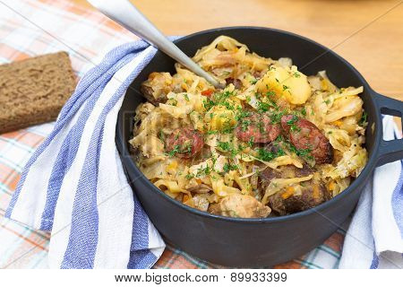 Traditional polish sauerkraut bigos with mushrooms