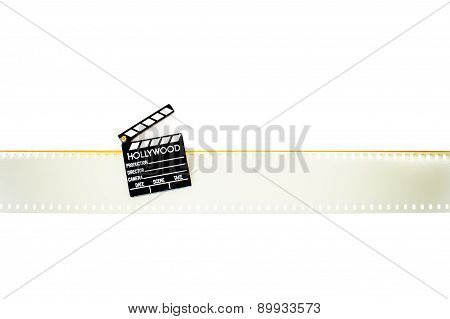 Little Clapper Board On Empty 35 Mm Movie Filmstrip Isolated