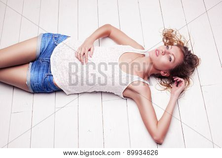 sexy blonde with wet hair woman posing in studio
