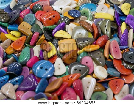 Many  Colored Buttons Of Various Shapes  On Each Other