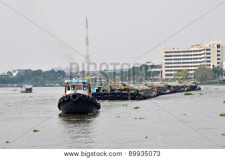 Tug Boat Drags Sand Barge On Chao Phraya River