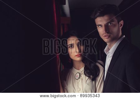Retro Fashionable Couple At Vintage Train Car