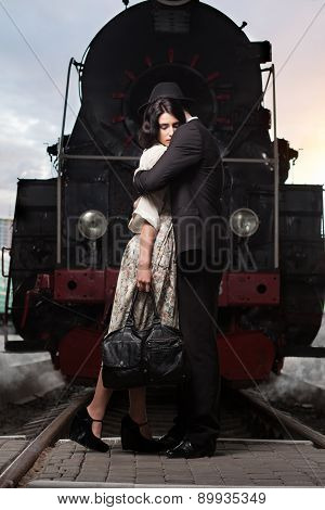 Parting Of Lovely Couple On Railway Station At Locomotive Background