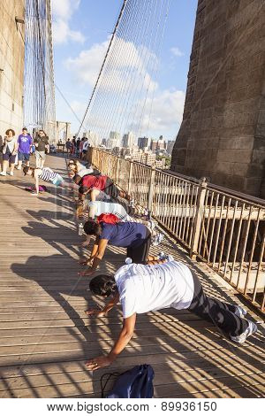 People Enjoy Exercises At Brooklyn Bridge In New York