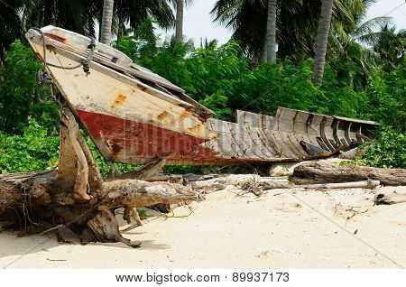 Destroyed Wooden Boat On The Beach