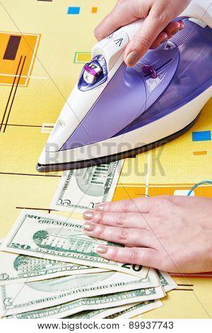 Ironing Dollars Banknote. Money Laundering