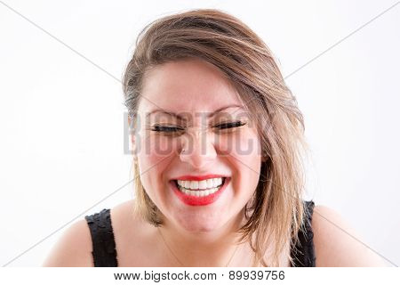 Woman Face In Toothy Laugh With Eyes Closed