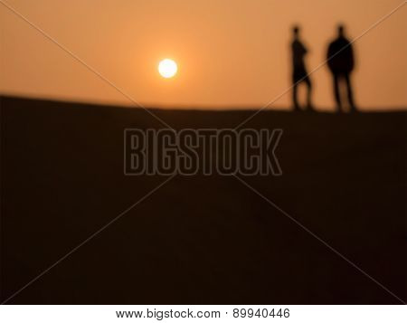 Abstract Image Of 2 Men At The Desert In Sunset Time