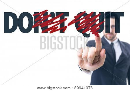 Business man pointing the text: Don't Quit
