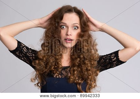 Surprised Woman With Long Curly Hair