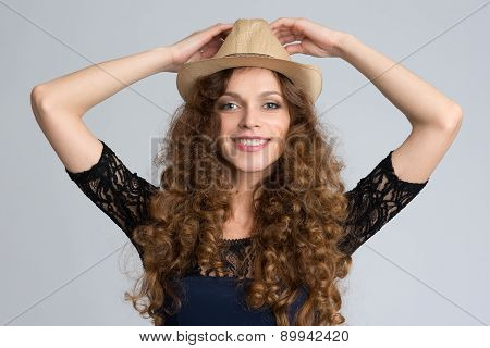 Beautiful Young Woman Wearing Hat And Smiling At Camera