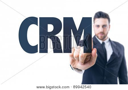 Business man pointing the text: CRM