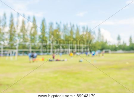 Blurred Shot Of Soccer Field At School On Day Time Image.