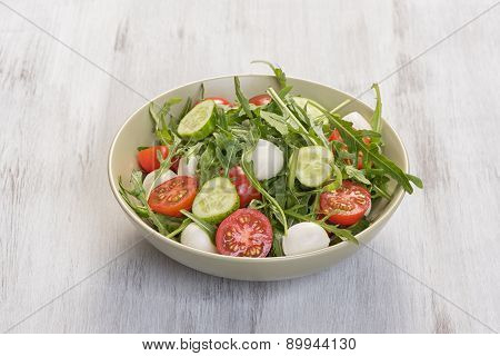Fresh Vegetable Salad With Mozzarella And Arugula