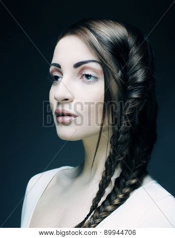 close up portrait of beautiful young blonde woman with creative braids hairdo