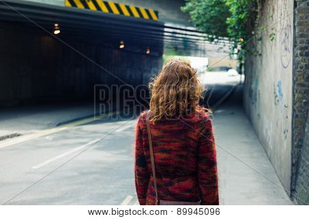 Woman Walking On The Street Near An Underpass
