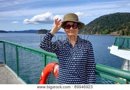 Senior Woman On Boat Dock Near Ocean During Nice Day