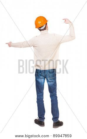 Back view of  pointing young men in helmet. Young guy  gesture. Rear view people collection.  backside view of person.  Isolated over white background. Foreman hands gives commands directions.