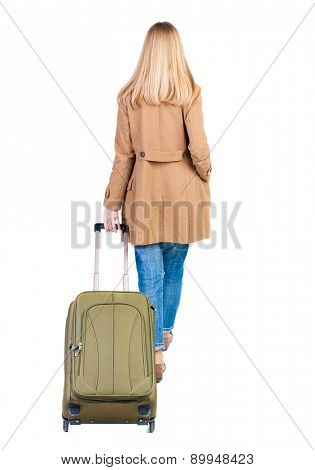 back view walking  woman  with suitcase. beautiful girl in motion.  backside view of person.  Rear view people collection. Isolated over white background. traveling teen girl/ thin girl rolls suitcase